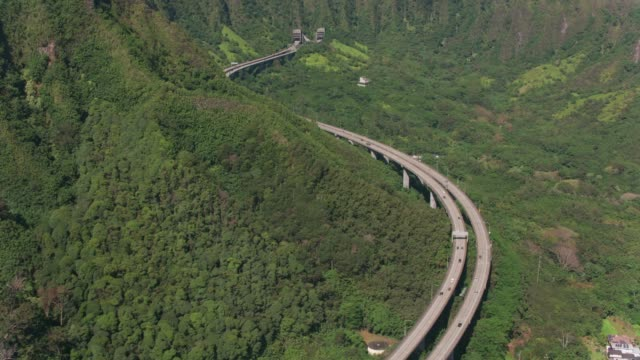 Aerial view of H3 highway winding through mountains. video