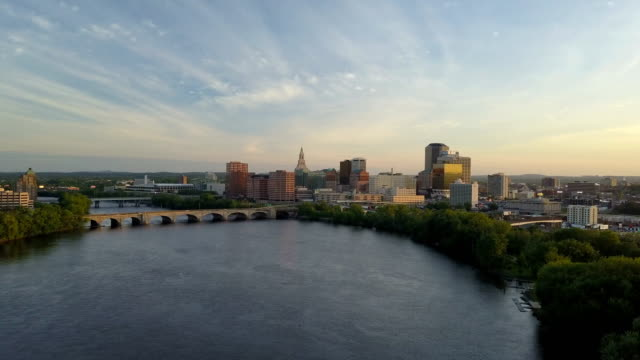 Aerial view of Hartford, CT skyline Aerial video of Hartford, CT skyline during sunset, Connecticut river, bridges and I-84, I-91 interstates included. connecticut stock videos & royalty-free footage