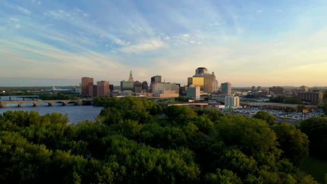 Aerial view of Hartford, CT skyline Aerial video of Hartford, CT skyline at sunset, Connecticut river, bridges and I-84, I-91 interstates included. connecticut stock videos & royalty-free footage