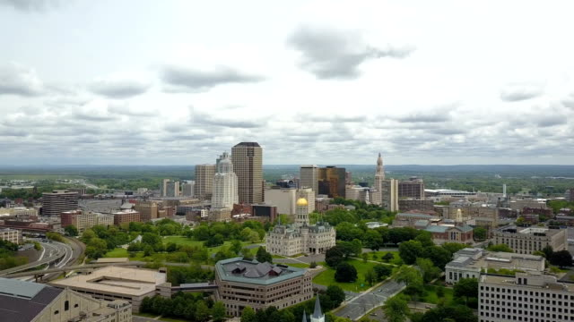 Aerial view of Hartford, CT skyline Aerial video of Hartford, CT skyline on cloudy spring day, forward and moving up, I-84, Capitol and Bushnell park. connecticut stock videos & royalty-free footage