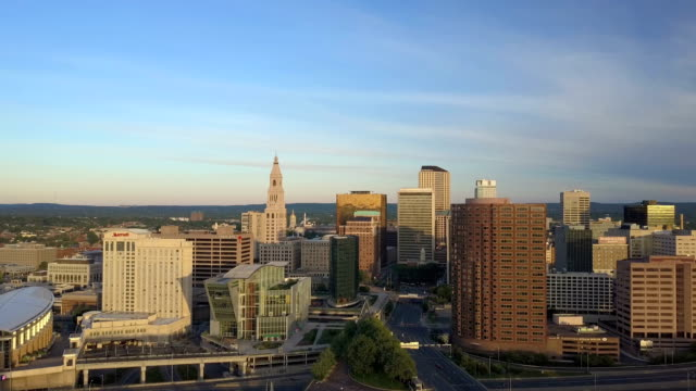 Aerial view of Hartford, CT skyline Aerial video, approaching Hartford, CT skyline during spring morning sunrise , Connecticut Science Center, Phoenix Building, Mortensen Riverfront Plaza and Gold Building included. connecticut stock videos & royalty-free footage
