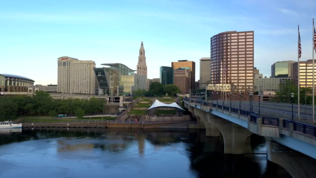 Aerial view of Hartford, CT skyline Aerial video, ascending over Hartford, CT skyline during spring morning sunrise , Connecticut Science Center, Phoenix Building, Mortensen Riverfront Plaza and Gold Building included. connecticut stock videos & royalty-free footage