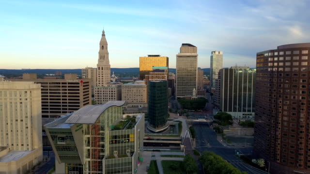 Aerial view of Hartford, CT skyline Aerial video, descending over Hartford, CT skyline during spring morning sunrise , Connecticut Science Center, Phoenix Building, Mortensen Riverfront Plaza and Gold Building included. connecticut stock videos & royalty-free footage