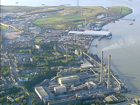 Aerial view of heavy industry on river. NTSC, PAL video