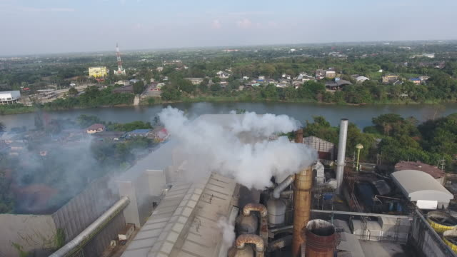 Aerial View of Heavy Industry Plant. Smoking Pipes, Fumes Factory