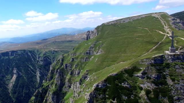 Aerial view of Heroes Cross on Caraiman Peak, Romania video