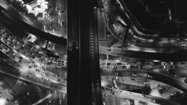 Aerial view of highway crossroad during twilight night - vídeo