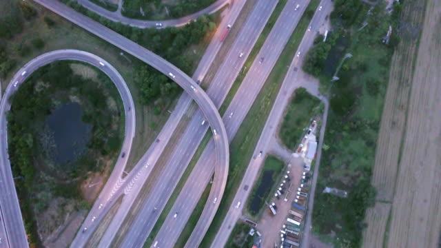 aerial view of highway crossroad rush hour traffic - droga wielopasmowa filmów i materiałów b-roll