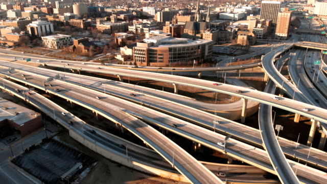 Aerial view of highway in american city at dawn. Downtown Milwaukee, Wisconsin, United States. Drone shots, from above
