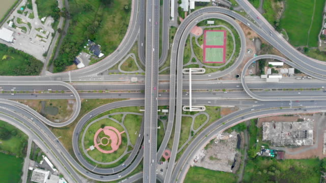 Aerial view of highway interchange Aerial view of partial cloverleaf highway interchange in Bangkok, Thailand shamrock stock videos & royalty-free footage
