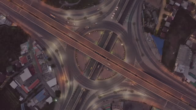 Aerial view of highway junctions Top view of Urban city, Bangkok, Thailand. – film