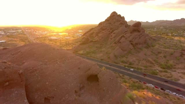 Aerial View of Highway Road Cuts Through Mountains on Outskirts of Phoenix, Arizona