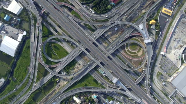 Aerial View of Highway Road Interchange with Busy Urban Traffic Speeding on Road video