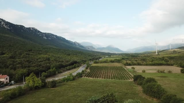 Aerial view of hills and vineyards in the Mediterranean countryside of eastern Pyrenean, France Aerial view of hills and vineyards in the Mediterranean countryside of Fenouilledes in the eastern Pyrenean, France provence alpes cote d'azur stock videos & royalty-free footage