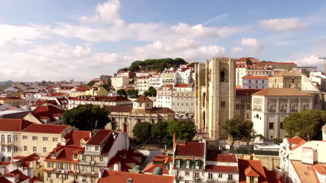 Aerial view of historical part of Lisbon and Lisbon Cathedral at sunny day Portugal video