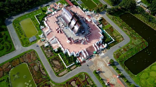 Aerial view of Ho Kham Luang (Royal Pavilion) In Royal Park Rajapruek, temple building style landmark of Chiang Mai, Thailand. video