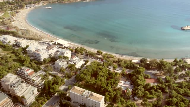 Aerial view of holiday buildings in front of the beach at Alithini, Syros island Aerial view of holiday buildings in front of beach at Alithini, Syros island Greece. aegean islands stock videos & royalty-free footage