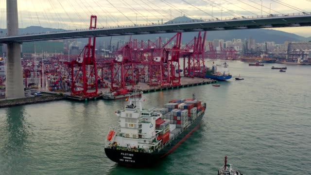 Aerial view of Hong Kong Kwai Tsing Container Terminals and Stonecutters bridge at dusk Aerial view of Hong Kong Kwai Tsing Container Terminals and Stonecutters bridge that connecting Nam Wan Kok, Tsing Yi to Stonecutters Island. commercial dock stock videos & royalty-free footage