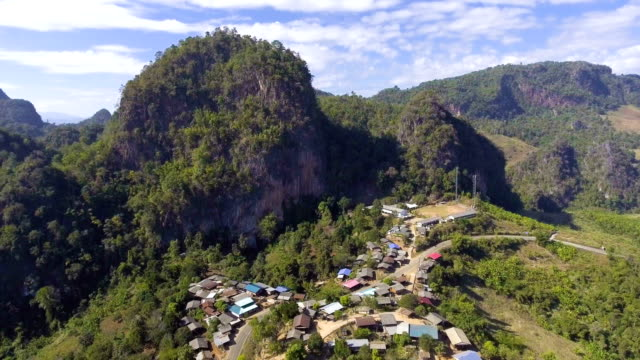 Aerial view of idyllic village along mountain cliff video