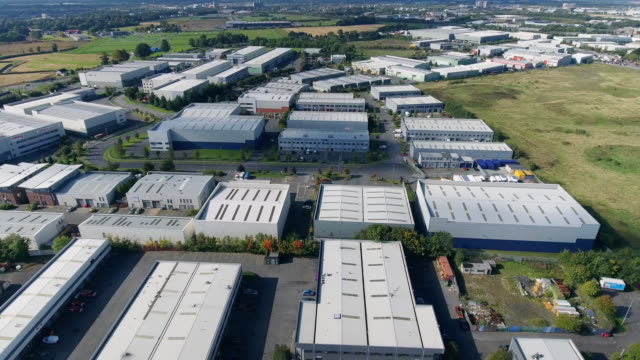 Aerial view of industrial buildings in a business park Aerial view of industrial buildings in a business park warehouse stock videos & royalty-free footage