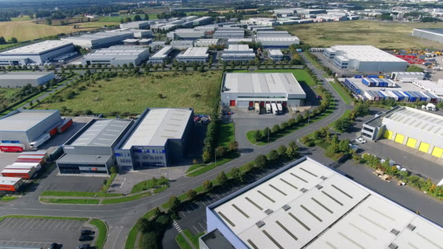 Aerial view of industrial buildings in a business park video