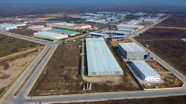 Aerial view of industrial buildings, Production Plant Area, refinery, Manufacturing plant. video