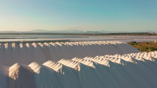 aerial view of industrial extraction of salt in the desert, pile of salt - salt video stock e b–roll