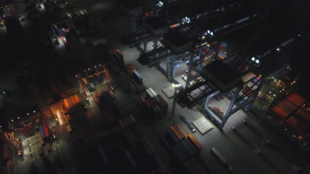 vídeos de stock e filmes b-roll de aerial view of industrial port with containers ship at night, bangkok, thailand - drone shipyard night