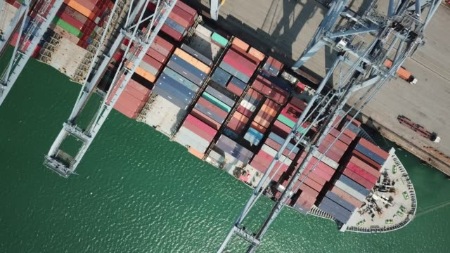 Aerial view of Industrial port with containers ship Aerial view of Industrial port with containers ship commercial dock stock videos & royalty-free footage