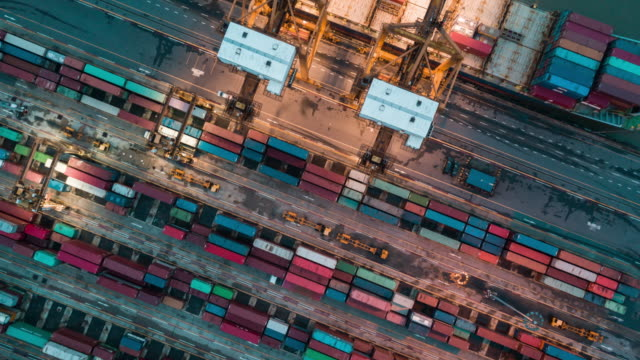 vídeos de stock e filmes b-roll de aerial view of industrial port with containers ship,time lapse - docas