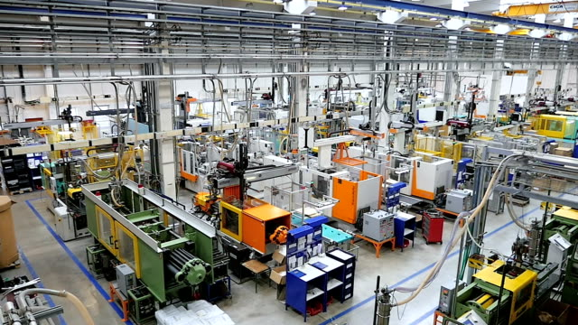 Aerial view of injection molding machines in factory video
