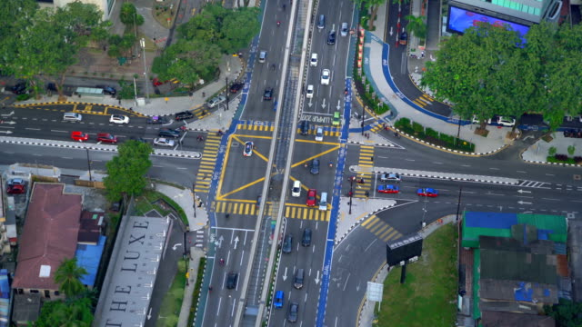 aerial view of intersection or junction in kuala lumpur downtown, malaysia. financial district and business centers in smart urban city in asia. skyscraper and high-rise buildings at sunset. - kuala lumpur video stock e b–roll