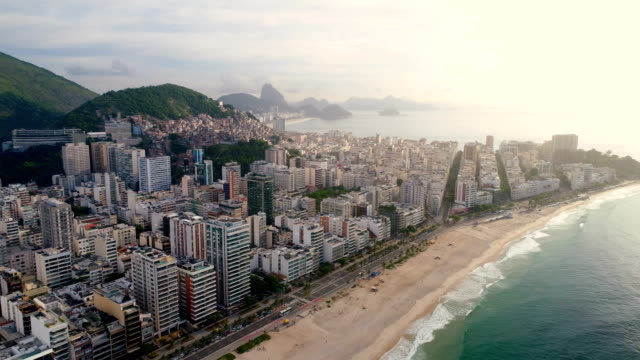 Aerial view of Ipanema Beach in Rio de Janeiro, Brazil. Aerial view of Ipanema Beach in Rio de Janeiro flying towards Copacabana Beach and Sugarloaf Mountain, Brazil. Vintage colors brazil stock videos & royalty-free footage