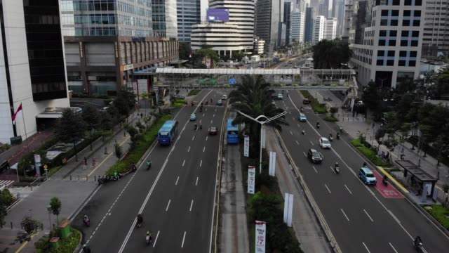 Aerial view of Jakarta city Scene at Sudirman road with flowing traffic jakarta stock videos & royalty-free footage