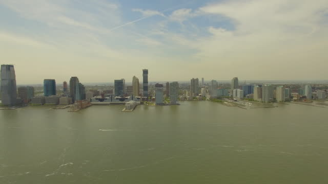Aerial view of Jersey city. Flying above Hudson river in New York city. 4K