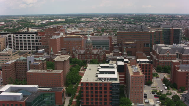 Aerial view of Johns Hopkins Hospital building. Baltimore, Maryland circa-2017, Aerial view of Johns Hopkins Hospital building.  Shot with Cineflex and RED Epic-W Helium. medical building stock videos & royalty-free footage