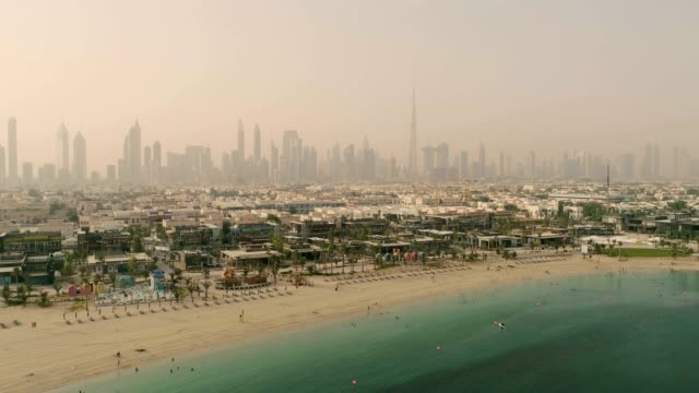 aerial view of jumeirah public beach during a dusty day, dubai, u.a.e. - dubai architecture stock videos & royalty-free footage
