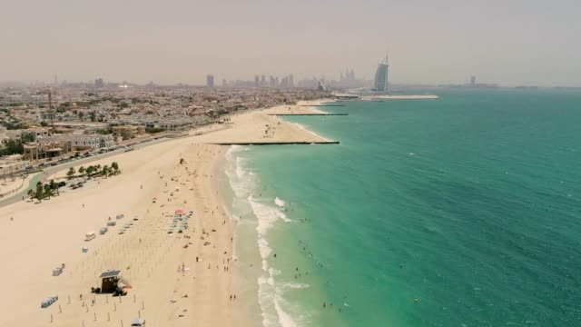 Aerial view of Jumeirah public beach during a dusty day, Dubai, U.A.E. Aerial view of Jumeirah public beach during a dusty day, Dubai, U.A.E. dubai architecture stock videos & royalty-free footage