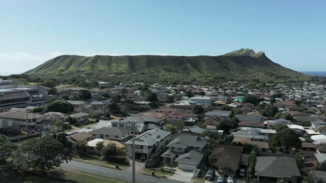 Aerial view of Kaimuki towards Diamond Head crater on Oahu - video