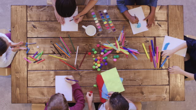 aerial view of kids doing arts and crafts - school supplies stock videos and b-roll footage
