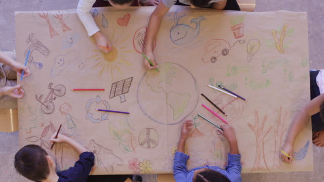 aerial view of kids doing arts and crafts - progettare video stock e b–roll