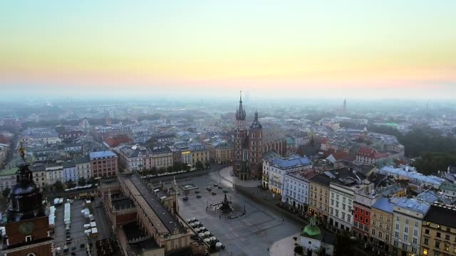 aerial view of krakow historic market square, poland, central europe at morning. - polonia video stock e b–roll