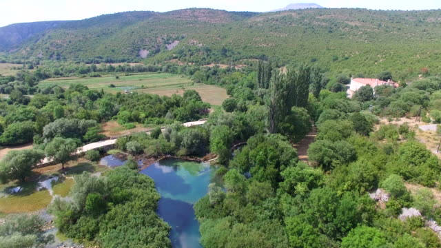 Aerial view of Krupa River next to the Krupa monastery, Croatia video