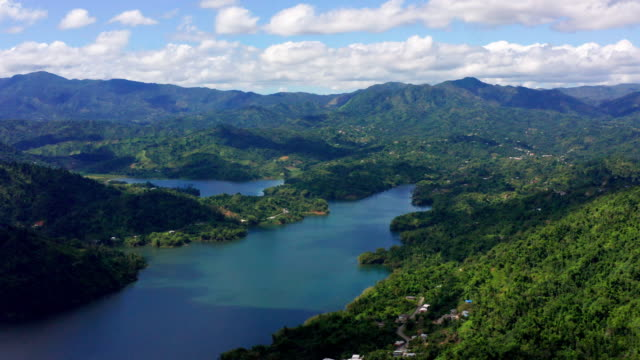 Aerial view of lake and sky Aerial view of lake and sky at caonillas lake puerto rico stock videos & royalty-free footage