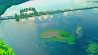 istock Aerial view of lake and small heart-shaped island. Unusual natural phenomena 1321285476