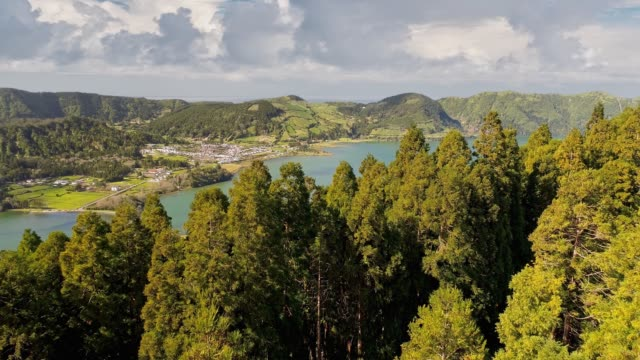 vídeos de stock e filmes b-roll de aerial view of lakes and town on sao miguel island, azores, portugal. flying over lagoa das sete cidades, azores islands. - portugal