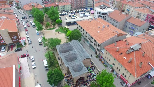 Aerial view of 'Lale' mosque and whorshipers in the courtyard/Kirsehir Kirsehir/Turkey 01/10/2016 Aerial view of 'Lale' mosque and whorshipers in the courtyard/Kirsehir Kirsehir/Turkey 01/10/2016 general view stock videos & royalty-free footage