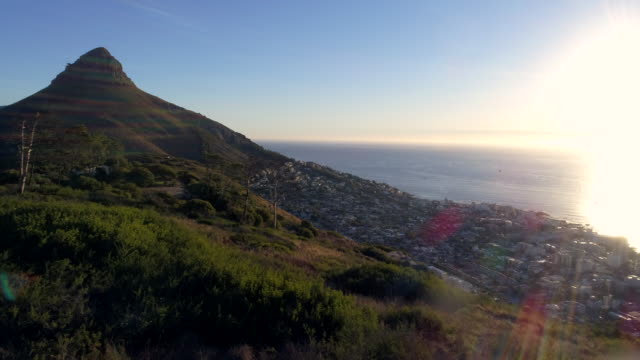 Aerial view of Lion's head mountain and surroundings Aerial view of Lion's head mountain and Cape Town city, beautiful seascape at sunset. Drone shot, 4K resolution. cape peninsula stock videos & royalty-free footage