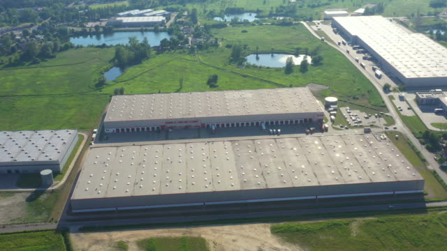 Aerial View of Loading Warehouse with Semi Truck. Aerial Aerial View of Loading Warehouse with Semi Truck. Aerial warehouse aerial stock videos & royalty-free footage