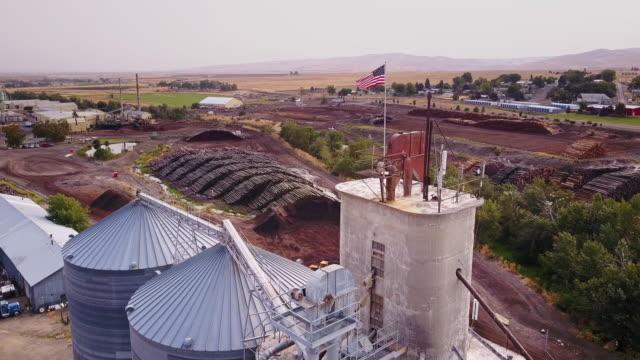 Aerial View of Lumber Yard Silo – film